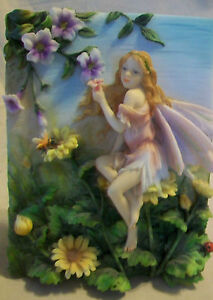 DECORATIVE THREE DIMENSIONAL FAIRY WALL PLAQUE WITH PURPLE FLOWERS