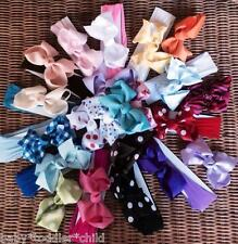 "Baby girls your choice of 4"" bow on nylon headband"