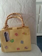 Ladies canvas purse, yellow with purses & bamboo handles and magnetic closure.