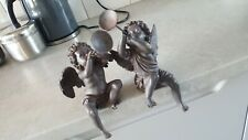 2 metal cherub with horns