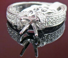 18 karat white gold ring with setting and diamonds