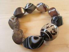 Vintage Botswana Banded Agate Four-Bat Carved Tagua Nut bracelet