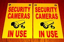 """(2) Security Cameras In Use Signs 8""""x12"""" New with Grommets Surveillance r/b/y"""