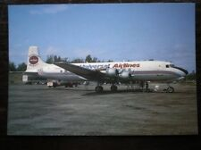 POSTCARD MCDONNEL DOUGLAS DC-6B AEROPLANE UNIVERSAL AIRLINES AT ANCHORAGE 7/91