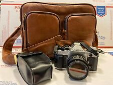 Canon AE-1 Program 35mm Film Camera with Case and 50mm 1.8 Lens and Flash