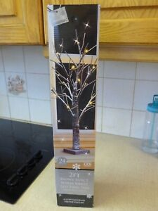 Snowy Effect Battery Operated Light-up Tree