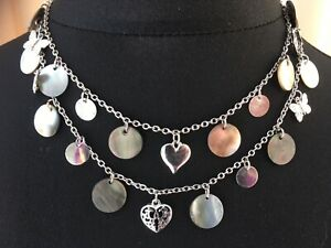 Long silvertone necklace with shell discs and silver charms - N024