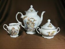 Trisa Porcelain Cherubs Teapot, Creamer and Sugar Bowl Hand Painted Gold Trim