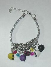 Silver & Plastic Rope Charm Bracelet w/ Multi-Colored Skull Beads