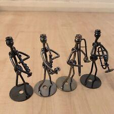 More details for 4 musical figure / figurines set iron saxophone clarinet trumpet etc