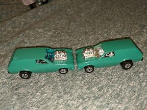 Hot Wheels France Poison Pinto with both window variations. Clear and green