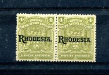 RHODESIA 1909-12 4d olive pair with 1 stamp showing the 'No stop' variety. Mint