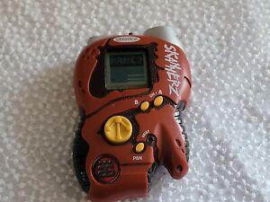 Radica Skannerz Red Ujalu Tribe 3 Handheld Game Electronic Bar Code Scanner