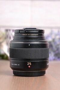 Panasonic Lumix Leica 25mm f/1.4 H-X025 Aspherical DG Lens with Caps & B+W UV