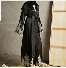 Abaya with gold lace sleeves and front crystals available in sizes XL