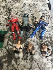 7 action figures Wrestling And Power Rangers