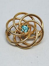 Cute Love Knot Gold Tone Pin with a center Turquoise Rhinestone