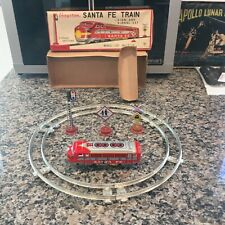 VINTAGE YONEZAWA TIN CLOCKWORK TRAIN DISTRIBUTED BY CRAGSTAN SANTA FE TRAIN SET.
