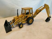 Vintage Ford 555A Backhoe/Loader By Ertl 1/32nd Scale  1996. Nice condition.