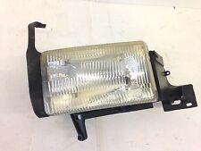 1994-1998 dodge ram headlight w/ mounting bucket ( driver )