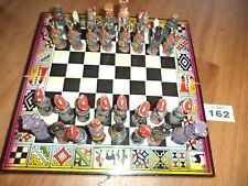UNUSUAL CHESS SET wooden box board and ornate china painted figures