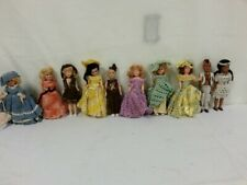 Vintage Lot of 10 small antique hard vinyl Dolls with handmade clothes rare