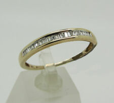 9ct yellow gold band ring with 0.27cts quality diamonds, channel set