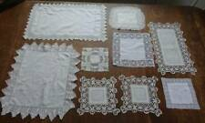 9 white Irish linen table toppers or table mats - all with lace trim.