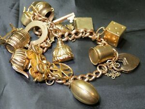 OLD 9CT GOLD CHARM BRACELET WITH 13 X 9CT GOLD CHARMS & 1 X 18CT - 64G - APPROX