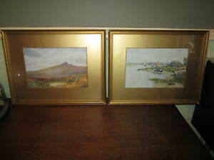 A pair of old gilt picture frames