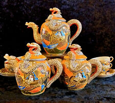 Orange dragon service, with 4 cups and saucers and cake set.