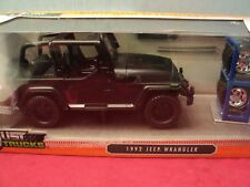 Jada 1992 Jeep Wrangler  1/24 scale 2016 release with /extra wheels black primer