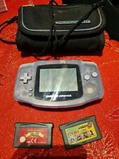 nintendo gameboy advance with 2 games and bag