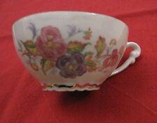 Deux tasses et sous-tasses en porcelaine de Limoges Saint Luc