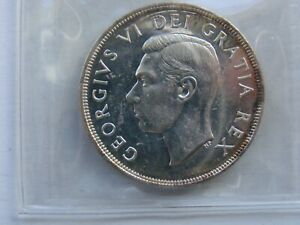 1948 Canada silver dollar ICCS MS 60.... under-graded