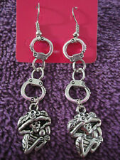 HAND CUFF WITH SKULL DANGLE EARRINGS 2 INCHES LONG