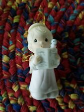 Precious moments ornaments. 15 years