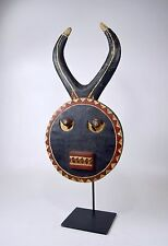 A Very Fine Old Baule Goli African Mask on professional display stand.
