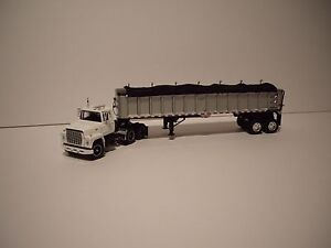 DCP 1/64 NEW WHITE FORD 9000 LOUISVILLE WITH SILVER W/T BLACK TARP EAST END DUMP
