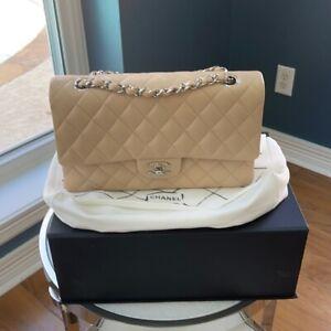 Beige Chanel Classic Medium Double Flap Bag.