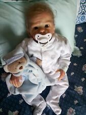"""Reborn 18"""" baby boy doll by Laura Tuzio Ross with certificate."""