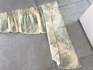 A 'Dorma' pair of cream, green and gold tails and matching pelmet