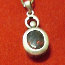 STERLING SILVER GARNET OVAL PENDANT WITH A 20 INCH CHAIN