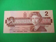 1986 Canada bill 2$ circulated AU 58.Thiessen-Crow.AUN8528508. Last one.