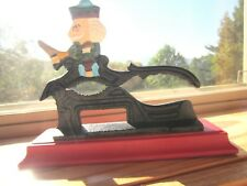 """Collectible Paul Revere Cast Iron Nut Cracker mounted on wooden base, 5.5"""" tall"""
