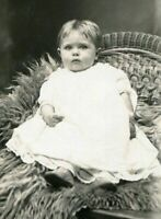 RPPC CUTE BRIGHT-EYED BABY on RATTAN CHAIR ANTIQUE REAL PHOTO POSTCARD