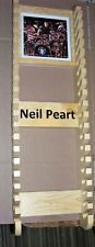 Neil Peart   (Middle age) Drumstick rack with picture frame holds 20 pairs