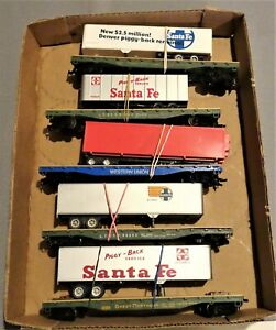 5 each USED HO SCALE FLAT CARS WITH A SEMI TRAILER ON THEM (11K)
