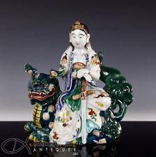 LARGE AND IMPRESSIVE ANTIQUE JAPANESE OKIMONO STATUE OF FIGURE ON LION