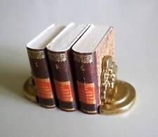 1:12 - 2 goldfarbene  Miniatur  Buchstützen ( 1 ) - Puppenhauszubehör